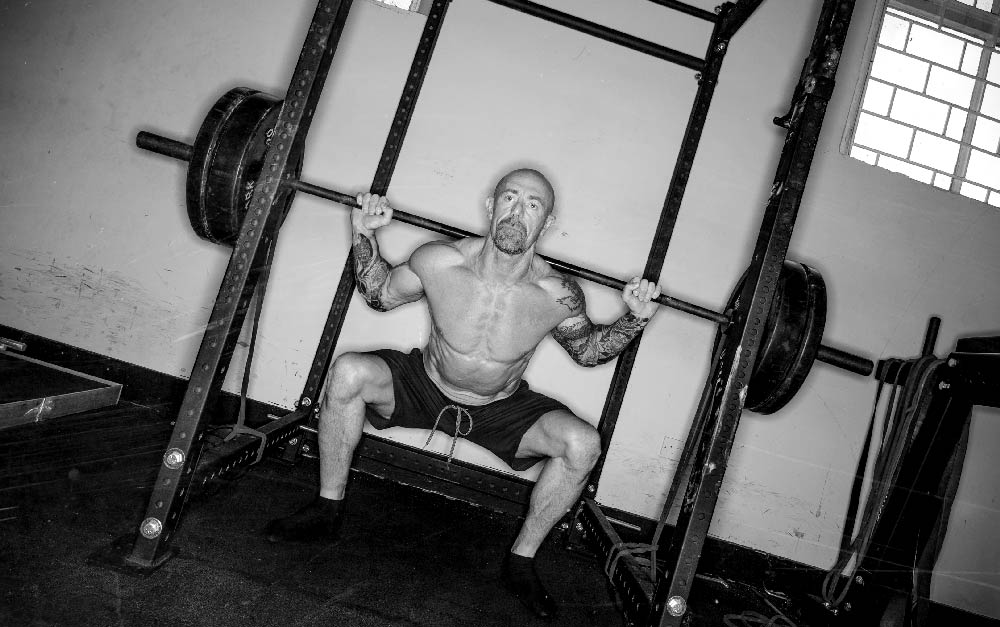 Steve Williams Squatting B&w